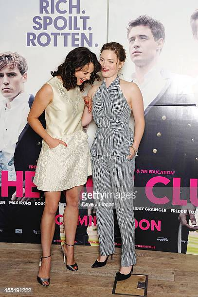 Jessica Brown Findlay and Holliday Grainger attend a photocall for the film 'The Riot Club' at The BFI Southbank London on September 15 2014 in...