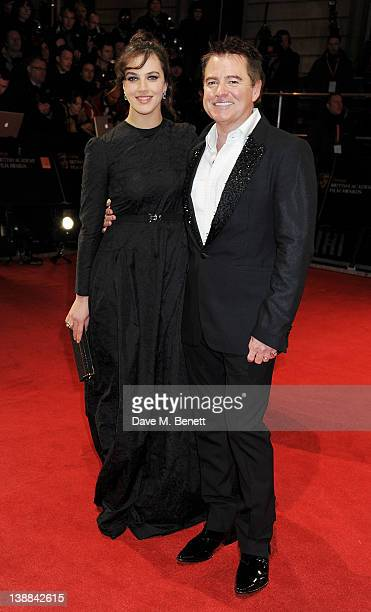 Jessica Brown Findlay arrives at the Orange British Academy Film Awards 2012 at The Royal Opera House on February 12 2012 in London England
