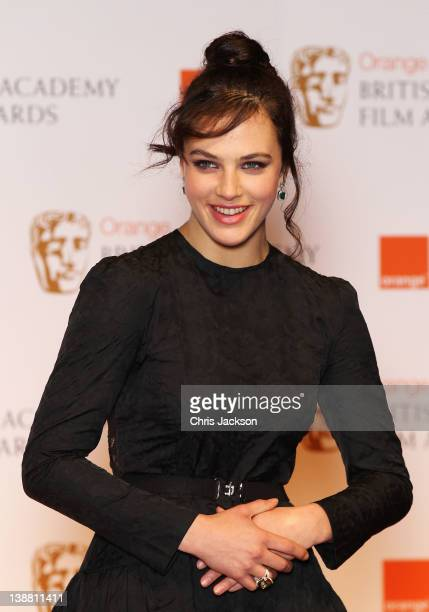 Jessica Brown Findlay poses in the press room during the Orange British Academy Film Awards 2012 at the Royal Opera House on February 12 2012 in...