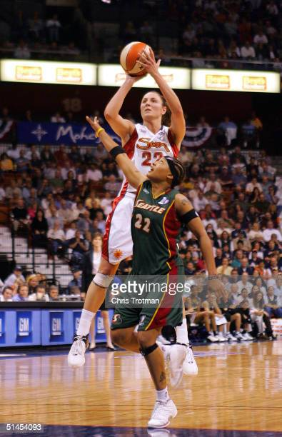 Jessica Brungo of the Connecticut Sun shoots over Betty Lennox of the Seattle Storm in Game 1 of the WNBA Finals on October 8, 2004 at the Mohegan...