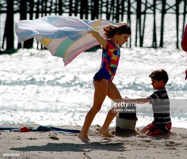 Jessica Burton looks like a human kite as she visted Buenaventura State Beach on a windy day