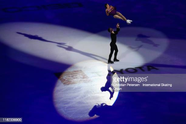 Jessica Calalang and Brian Johnson of the United States perform in the Skate America exhibition program during the ISU Grand Prix of Figure Skating...