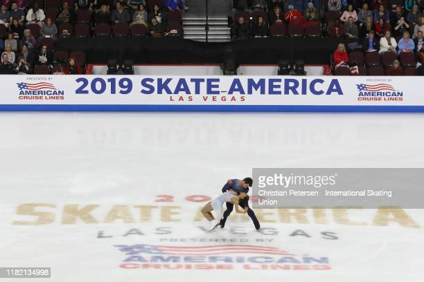Jessica Calalang and Brian Johnson of the United States perform during pairs free skating in the ISU Grand Prix of Figure Skating Skate America at...
