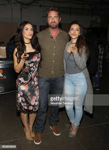Jessica Cediel and her sister Virginia Cediel are seen posing with Gerard Butler on the set of 'Despierta America' at Univision Studios on January 11...