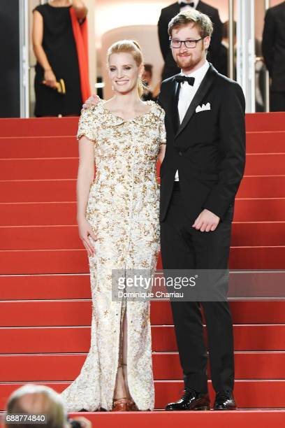 Jessica Chastain and guest attend the 'In The Fade ' premiere during the 70th annual Cannes Film Festival at Palais des Festivals on May 26 2017 in...