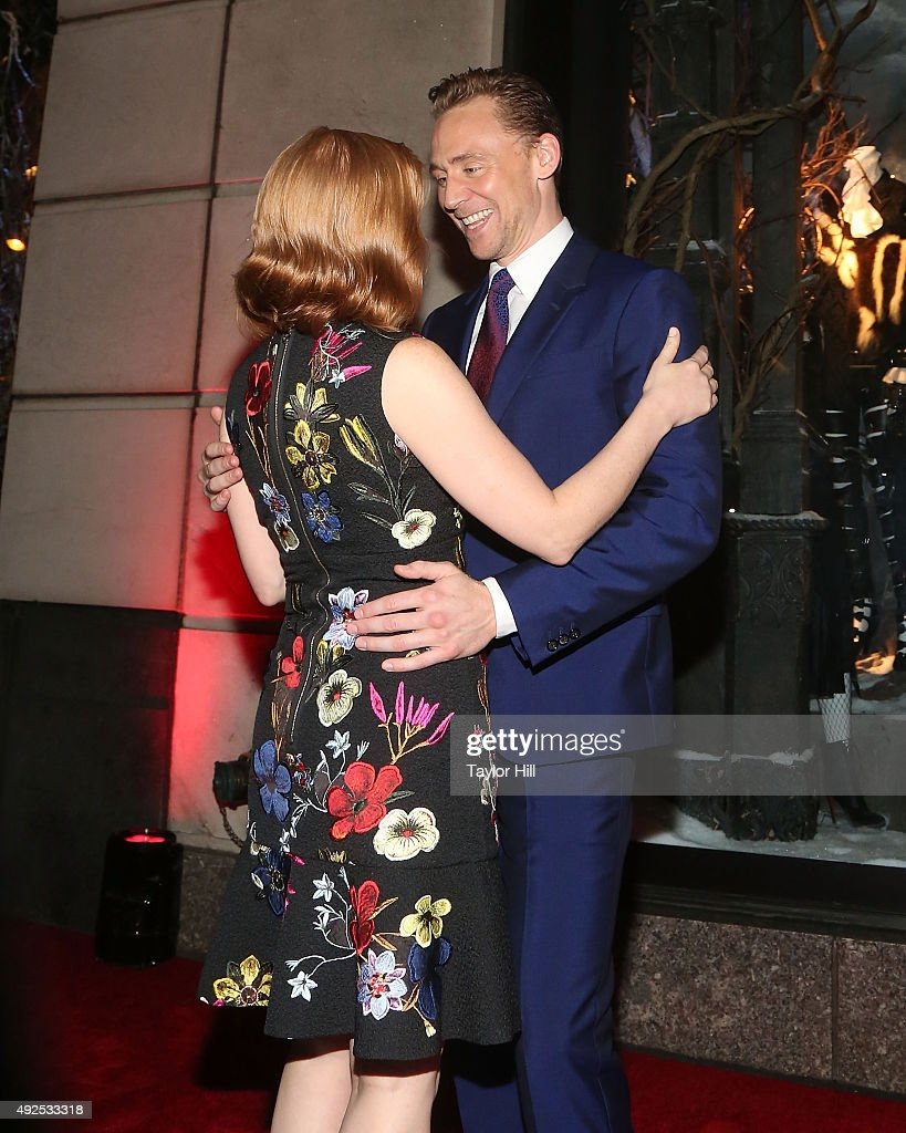 Jessica Chastain and Tom Hiddleston hug at a celebration of Bergdorf Goodman Windows inspired by the Legendary Pictures and Universal Pictures film, 'Crimson Peak' at Bergdorf Goodman on October 13, 2015 in New York City.