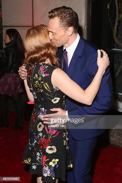 Jessica Chastain and Tom Hiddleston hug at a celebration of Bergdorf Goodman Windows inspired by the Legendary Pictures and Universal Pictures film...