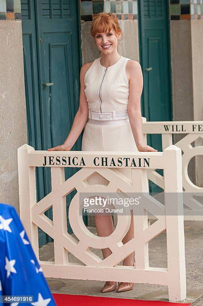 Jessica Chastain poses in front of her dedicated beach locker room on the Promenade des Planches on September 5 2014 in Deauville France