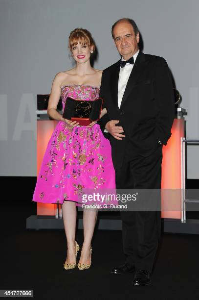 Jessica Chastain receives a tribute from new Cannes Film Festival President Pierre Lescure during the opening ceremony of 40th Deauville American...