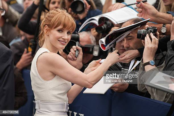 Jessica Chastain signs autographs as she arrives to unveil her dedicated beach locker room on the Promenade des Planches on September 5, 2014 in...