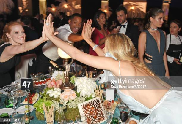 Jessica Chastain, Will Smith and Petra Nemcova attend the amfAR Gala Cannes 2017 at Hotel du Cap-Eden-Roc on May 25, 2017 in Cap d'Antibes, France.