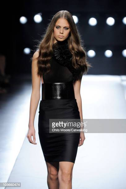 Jessica Clarke walks the runway at the Gianfranco Ferre' Spring Summer 2011 fashion show during Milan Fashion Week at on September 24 2010 in Milan...