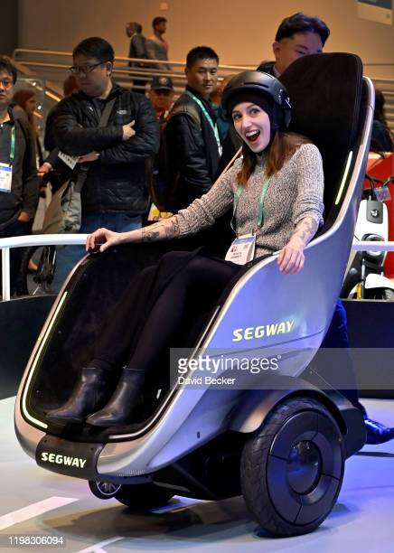 Jessica Conditt of New York rides in the Segway S-Pod during CES 2020 at the Las Vegas Convention Center on January 8, 2020 in Las Vegas, Nevada....