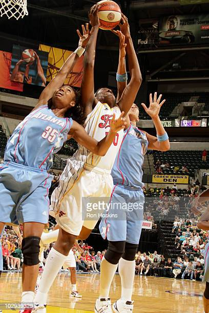 Jessica Davenport of the Indiana Fever battles Angel McCoughtry and Erika DeSouza of the Atlanta Dream for a rebound at Conseco Fieldhouse on July 16...