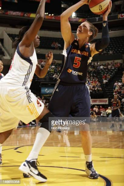 Jessica Davenport of the Indiana Fever battles Kelsey Griffin of the Connecticut Sun at Bankers Life Fieldhouse on June 21 2012 in Indianapolis...