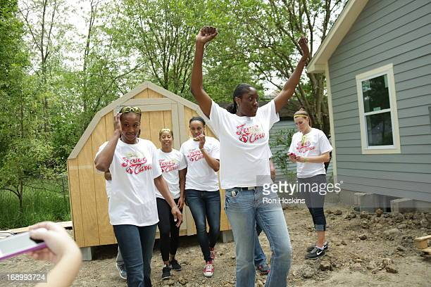 Jessica Davenport of the Indiana Fever celebrates as the Fever participated in a Habitat for Humanity build on May 17 2013 in Indianapolis Indiana...