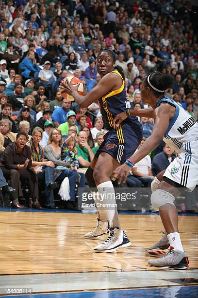 Jessica Davenport of the Indiana Fever looks to pass the ball against Taj McWilliamsFranklin of the Minnesota Lynx during the 2012 WNBA Finals Game...
