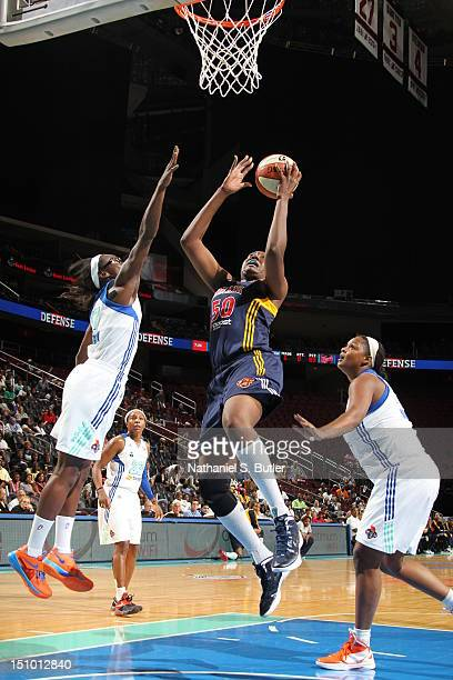 Jessica Davenport of the Indiana Fever shoots against Essence Carson of the New York Liberty during a game on August 30 2012 at the Prudential Center...