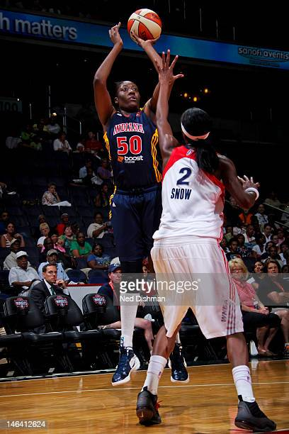 Jessica Davenport of the Indiana Fever shoots against Michelle Snow of the Washington Mystics at the Verizon Center on June 15 2012 in Washington DC...