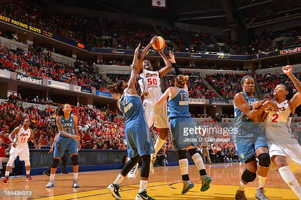 Jessica Davenport of the Indiana Fever shoots against Rebekkah Brunson and Lindsay Whalen of the Minnesota Lynx during Game three of the 2012 WNBA...