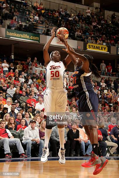 Jessica Davenport of the Indiana Fever shoots over Tina Charles of the Connecticut Sun in Game Two of the East Conference WNBA Finals at Banker's...