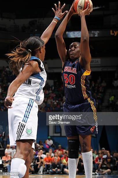 Jessica Davenport of the Indiana Fever shoots the ball against Taj McWilliamsFranklin of the Minnesota Lynx during the WNBA game on September 17 2012...