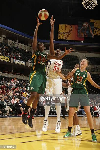 Jessica Davenport of the Indiana Fever tries to block the shot of Shekinna Stricklen of the Seattle Storm at Banker's Life Fieldhouse on September 12...