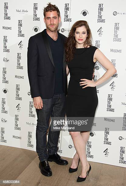 Jessica De Gouw and Oliver JacksonCohen attend the UK Premiere of 'Set Fire To The Stars' at Ham Yard Hotel on October 28 2014 in London England
