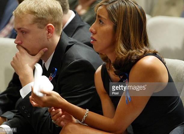 Jessica De La Rosa holds back tears during memorial services for her boyfriend Patrick James Dennehy August 7 2003 at the Jubilee Christian Center in...