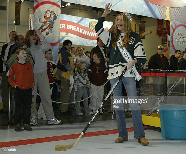 Jessica Dereschuk reigning Miss Minnesota celebrates after she scored in the Shoot and Score contest in the NHL FANtasy area during the NHL AllStar...