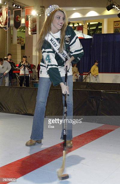 Jessica Dereschuk reigning Miss Minnesota takes a shot in the Shoot and Score game at the NHL FANtasy during the NHL AllStar Weekend on February 4...