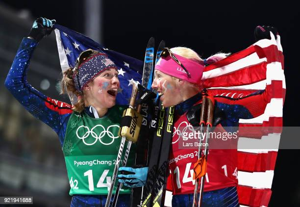 Jessica Diggins of the United States and Kikkan Randall of the United States celebrate as they win gold during the Cross Country Ladies' Team Sprint...