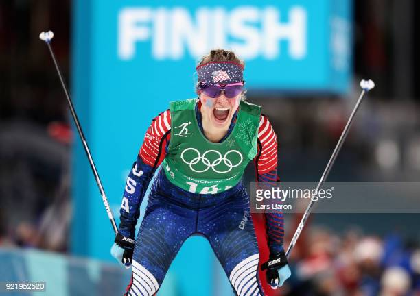 Jessica Diggins of the United States celebrates as she crosses the line to win gold during the Cross Country Ladies' Team Sprint Free Final on day 12...