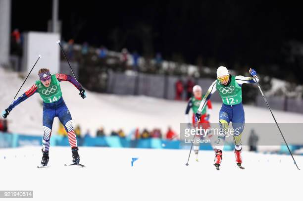 Jessica Diggins of the United States stretches across the finish line to win gold ahead of Stina Nilsson of Sweden during the Cross Country Ladies'...