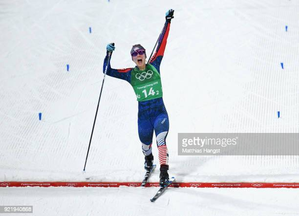Jessica Diggins of the United States stretches across the finish line to win gold during the Cross Country Ladies' Team Sprint Free Final on day 12...