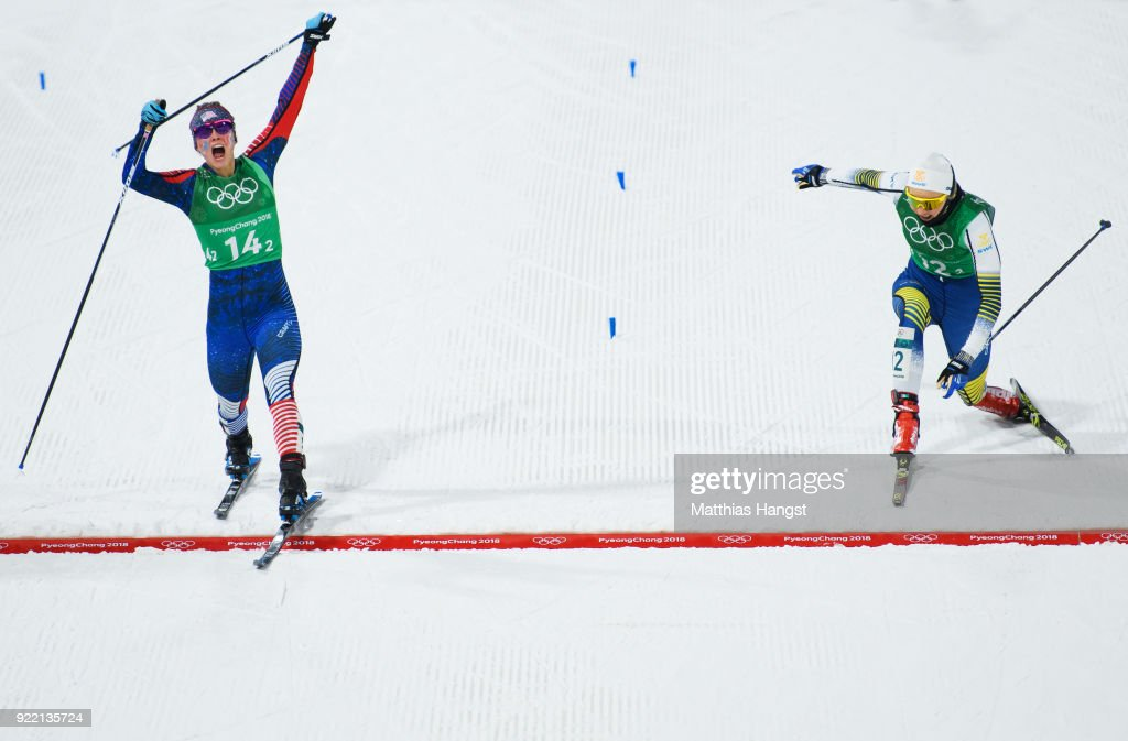 Jessica Diggins of the United States (14-2) stretches across the finish line to win gold ahead of Stina Nilsson of Sweden (12-2) during the Cross Country Ladies' Team Sprint Free Final on day 12 of the PyeongChang 2018 Winter Olympic Games at Alpensia Cross-Country Centre on February 21, 2018 in Pyeongchang-gun, South Korea.