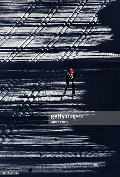 Jessica Diggins of USA cruises down the hill during cross country training ahead of the Sochi 2014 Winter Olympics at the Laura CrossCountry Ski and...