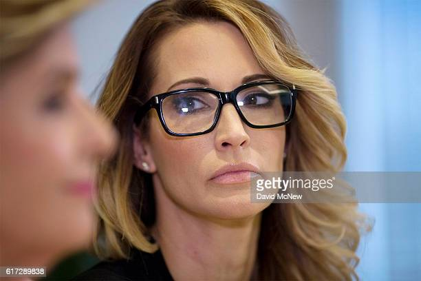 Jessica drake looks towards attorney Gloria Allred during a press conference to accuse Republican presidential candidate Donald Trump of previous...