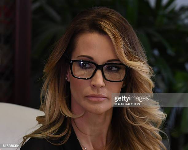 jessica drake who works for an adult film company listens as attorney Gloria Allred speaks about allegations of sexual misconduct against Republican...
