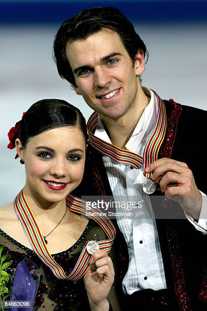 Jessica Dube and Bryce Davison pose for photographers after the Pairs Free Skate during the ISU Four Continents Figure Skating Championships at...
