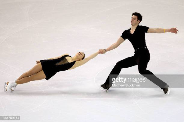 Jessica Dube and Sebastien Wolfe of Canada compete in the Pairs Short Program during the ISU Four Continents Figure Skating Championships at World...