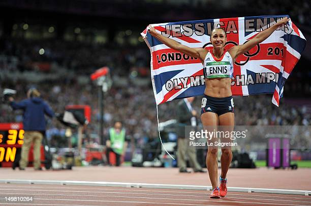 Jessica Ennis celebrates after winning gold in the heptathlon on Day 8 of the London 2012 Olympic Games at Olympic Stadium on August 4 2012 in London...