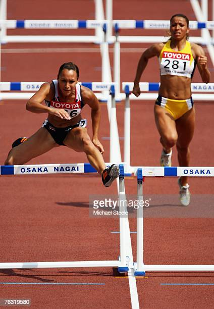 Jessica Ennis of Great Britain and Lucimara da Silva of Brazil compete in the 100m Hurdles during the Women's Heptathlon on day one of the 11th IAAF...