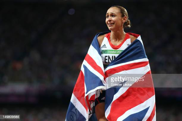 Jessica Ennis of Great Britain celebrates winning gold in the Women's Heptathlon on Day 8 of the London 2012 Olympic Games at Olympic Stadium on...