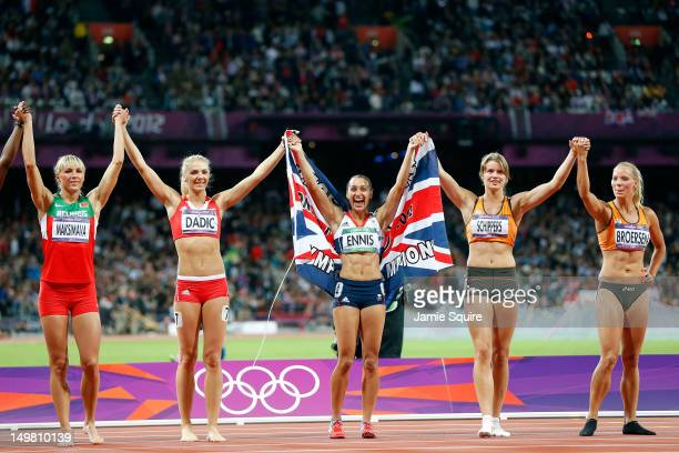 Jessica Ennis of Great Britain celebrates winning gold in the Women's Heptathlon with fellow heptathletes on Day 8 of the London 2012 Olympic Games...