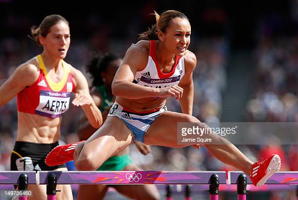 Jessica Ennis of Great Britain competes in the Women's Heptathlon 100m Hurdles Heat 1 on Day 7 of the London 2012 Olympic Games at Olympic Stadium on...