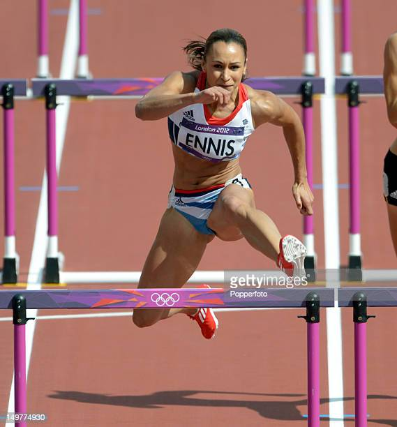 Jessica Ennis of Great Britain competes in the Women's Heptathlon 100m Hurdles on Day 7 of the London 2012 Olympic Games at Olympic Stadium on August...