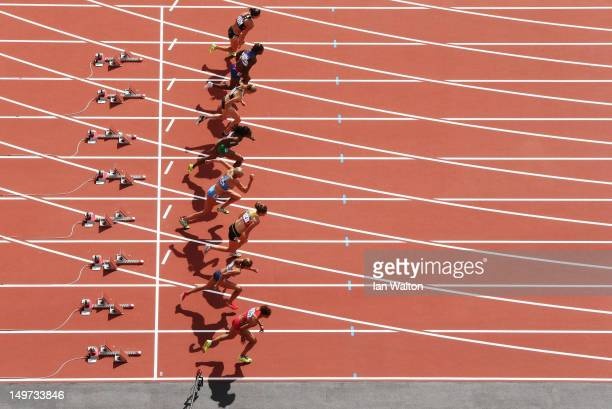 Jessica Ennis of Great Britain in lane 8 competes in the Women's Heptathlon 100m Hurdles Heat 1 on Day 7 of the London 2012 Olympic Games at Olympic...