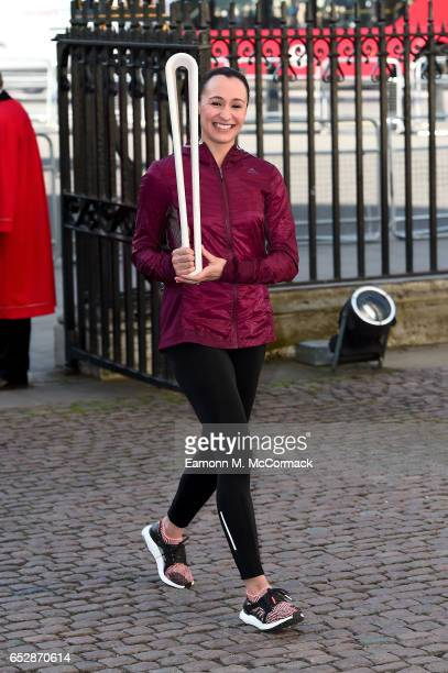 Jessica EnnisHill carrying the Commonwealth Games Baton as she attends the annual Commonwealth Day service and reception during Commonwealth Day...