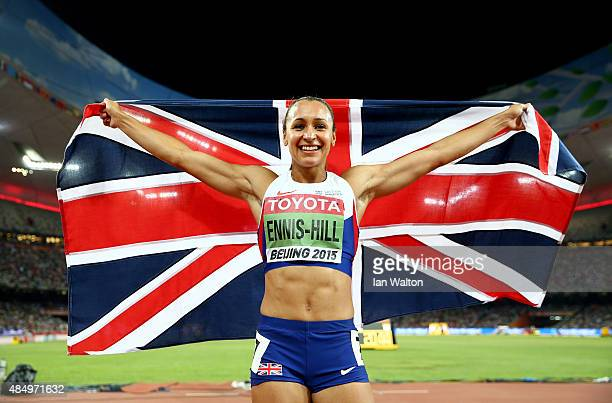Jessica Ennis-Hill of Great Britain celebrates after winning the Women's Heptathlon 800 metres and the overall Heptathlon gold during day two of the...